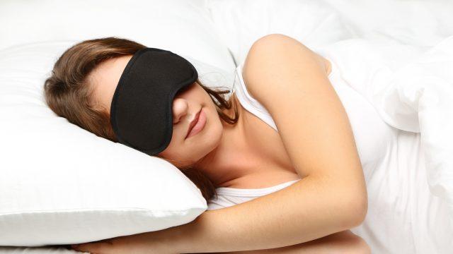 girl sleeping wearing silk eye mask