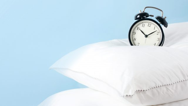 alarm clock on pillows