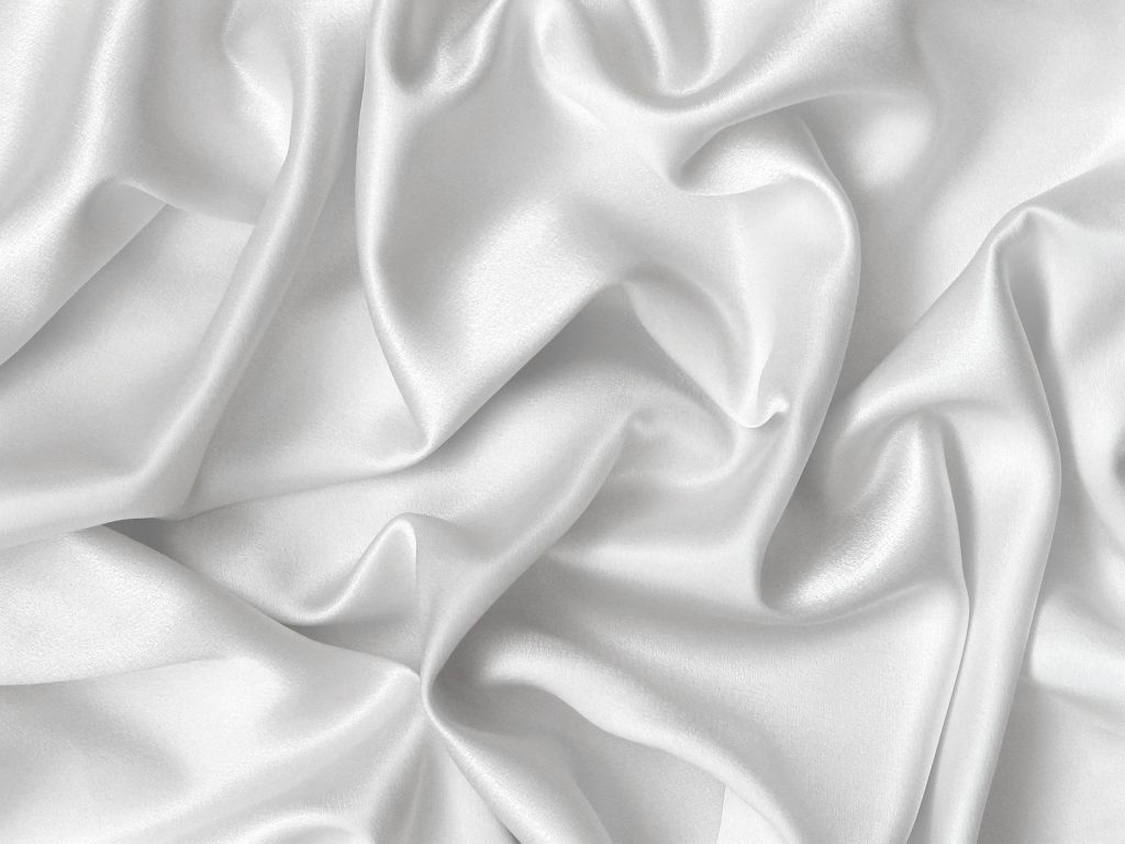Elegant folds of white silk. Close up.